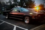 86 El Camino w/ the sunset reflecting off the paint
